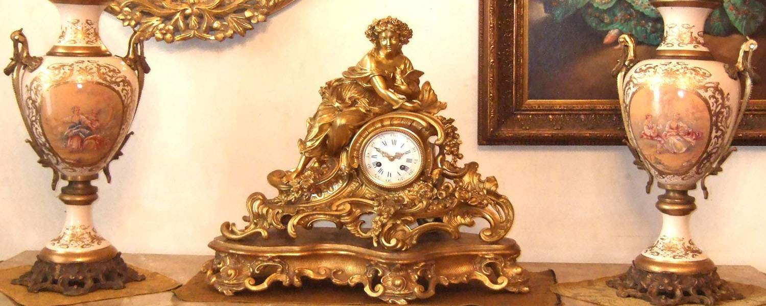 mantel clock and porcelain sevres vase